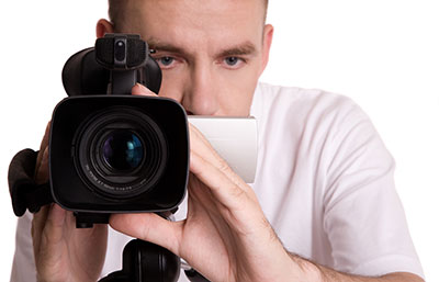 image of a man with a video camera